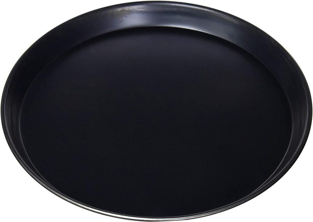 Bruciatura delle teglie in ferro blu